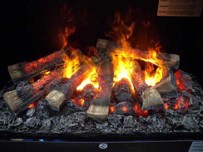 d trompez vous ces buches en flammes ne sont pas r elles ce nouveau foyer lectrique utilise. Black Bedroom Furniture Sets. Home Design Ideas
